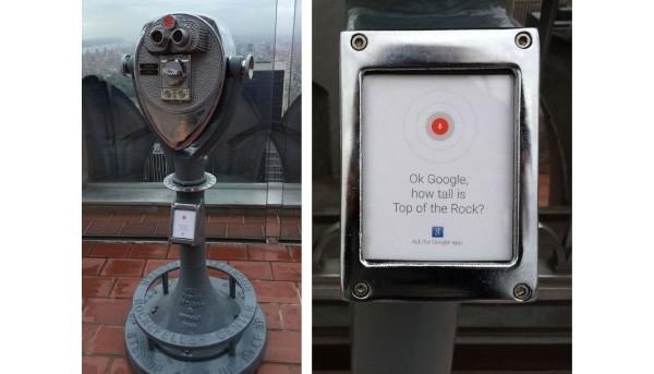 """La pubblicità di """"Ok Google"""" su un binocolo in cima al Rockefeller Center di Manhattan"""